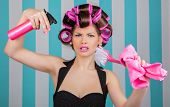 stock photo of multitasking  - stressed retro woman in rollers multitasking - JPG