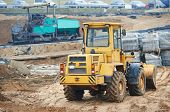 pic of wheel loader  - wheel loader excavator at construction earthmoving works - JPG