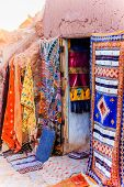 image of mud-hut  - Colorful mini textile business in a mud hut in the middle of the desert - JPG