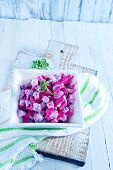 stock photo of lenten  - beet salad in bowl and on a table - JPG
