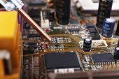 foto of rework  - Repairing of computer motherboard - JPG