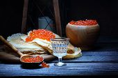 picture of vodka  - Red caviar on a thin openwork fritter and vodka in a transparent wine - JPG