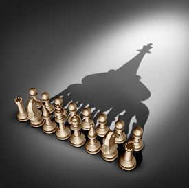 stock photo of joining  - Company leadership and team management vision as a business group concept with chess set pieces joining and working together united and as one in agreement to cast a shadow shaped as 