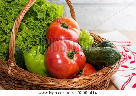 Fresh Vegetables In Basket. Tomato, Cucumber, Pepper And Lettuce