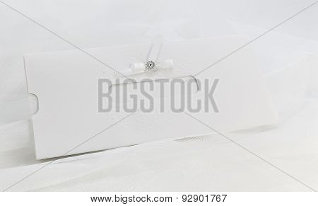 Invitation Card On White Tulle