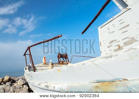 Profile View Of Obsolete Wooden Fishing Boat With Peeling Paint On Greek Kos Island