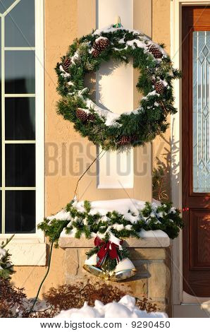 Christmas Wreath Covered With Snow