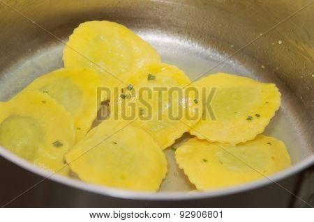 fry ravioli on pan. italian pasta