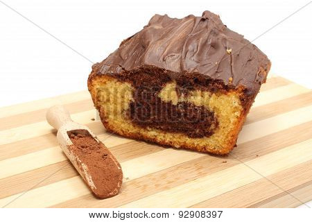 Chocolate Cake With Powdery Cocoa On Wooden Spoon