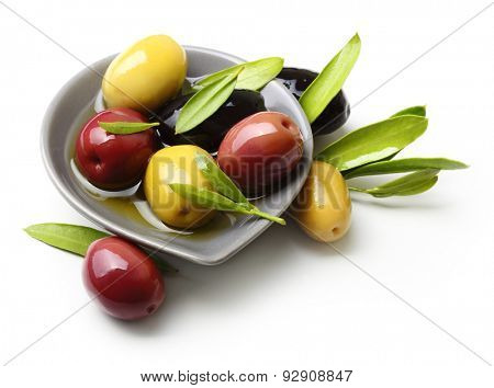 Olives with leaves isolated on white