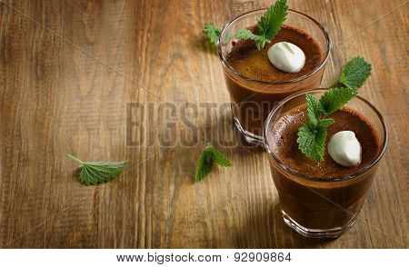Homemade Chocolate Mousse In Glasses On  Rustic Wooden Table.
