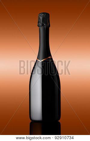 Bottle Of Sparkling Wine On Background Bronzed