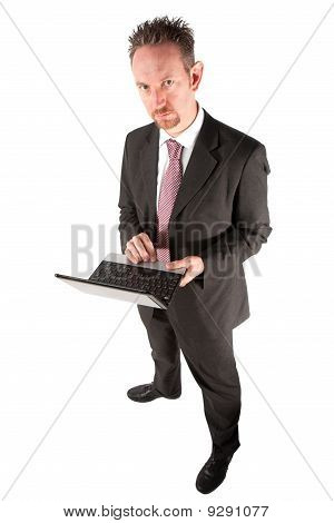 Standing Businessman Using Computer