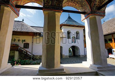 Inside View Of The Old Orthodox Polovragi Monastery Seen Trough A Colonade