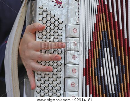 Young Woman Plays The Ancient Accordion Keyboard