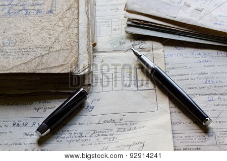 Old documents and pen