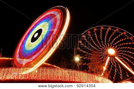 Ferris wheel and a ride during the Carnival of Light festival