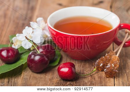 Black English Tea In Red Cup With Cherry