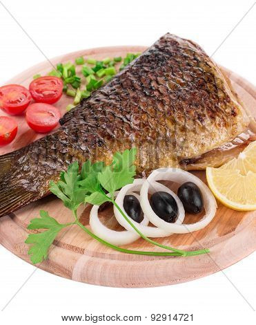 Fried carp tail with olives and onion.
