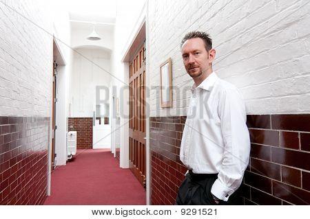 White Shirt Man In Tiled Corridor
