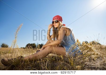 Beautiful Hippie Looking Girl Sitting On A Meadow - Morning Shot