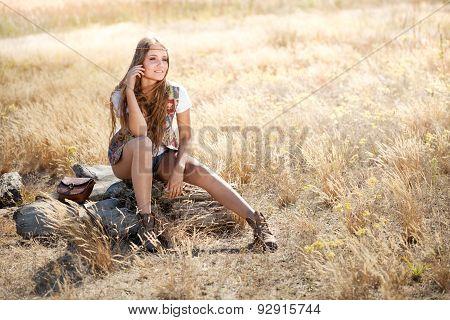 Beautiful Hippie Girl Sitting On A Tree Stump