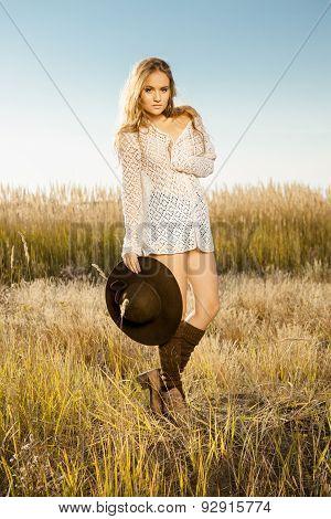 Sunrise Shot Of A Lady Model On Meadow