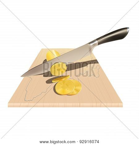 A knife cuts the coins on the board