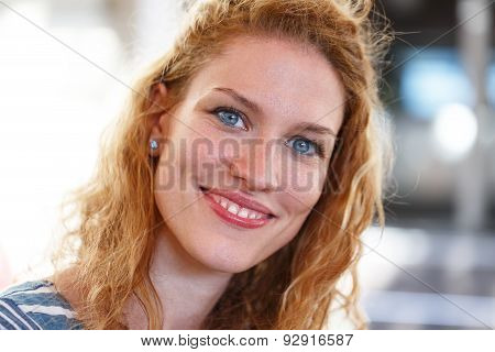 Redhead Woman With Curly Hair