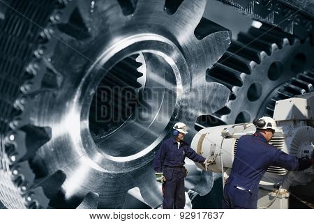 engineers, workers with giant cogwheel and gears machinery, metal indutry