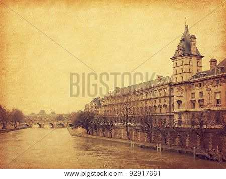 The Seine near the Pont Neuf, Paris, France. Photo in retro style. Added paper texture. Toned image