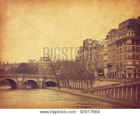 Seine,Paris, France.  Photo in retro style. Added paper texture. Toned image