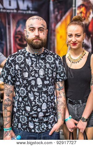 KRAKOW, POLAND - JUNE 6, 2015: Unidentified participants at 10-th International Tattoo Convention in Congress-EXPO Center. This year anniversary TattooFest - tattoo Studio is with an area of 2000m2