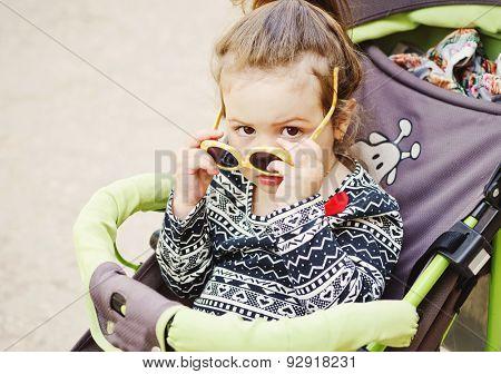 Cute Toddler In Stroller