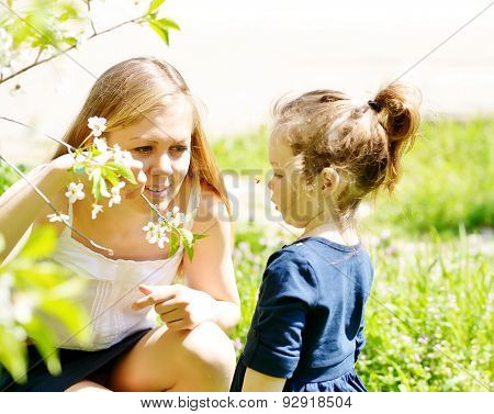Mother And Girl In Blossom Garden