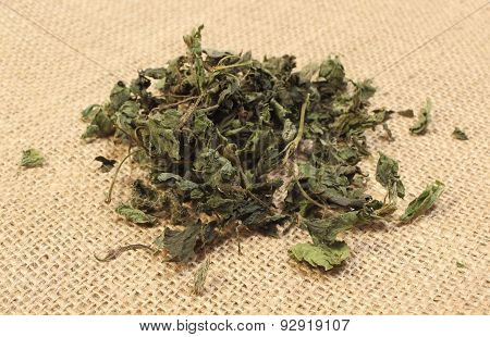 Heap Of Dried Nettle On Jute Canvas