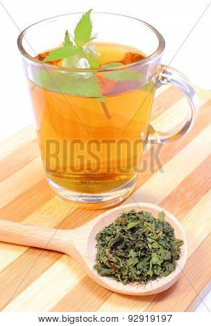 Fresh And Dried Nettle With Cup Of Beverage