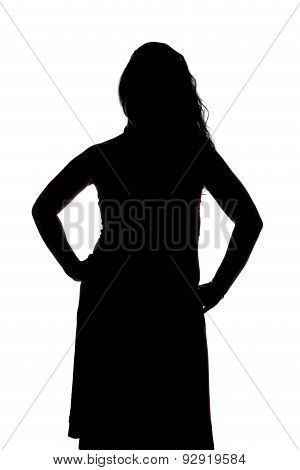 Silhouette of curvy woman with hands on hips