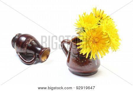 Yellow Flowers Of Dandelion In Brown Vase