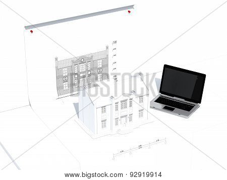 Model of house and laptop on the table