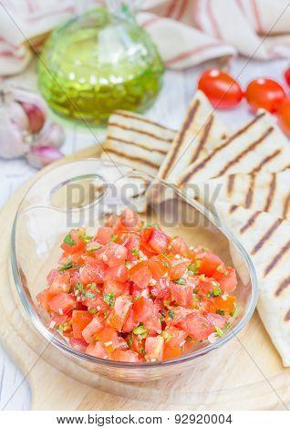 Bowl Of Fresh Homemade Salsa With Quesadilla