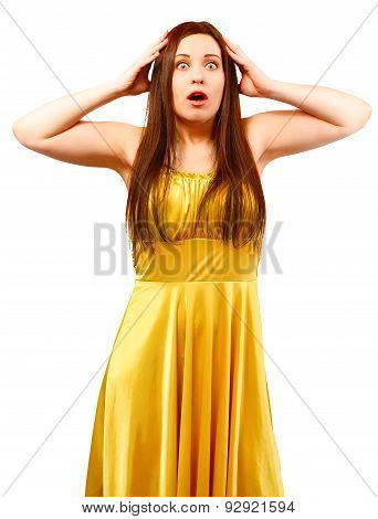 Surprised Woman In Yellow Dress With Open Mouth Holding Head