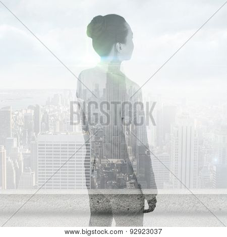 Unsmiling asian businesswoman against cityscape