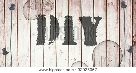The word diy against wooden background with plugs
