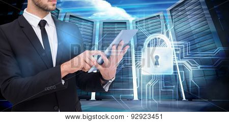 Mid section of a businessman using digital tablet pc against composite image of server room