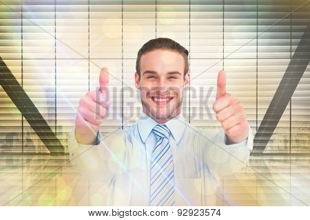 Positive businessman smiling with thumbs up against window overlooking city