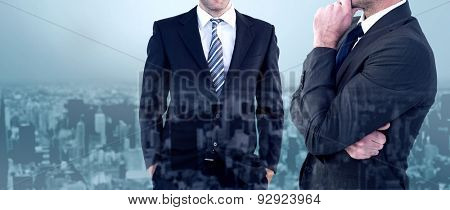 Frowning businessman thinking against high angle view of city