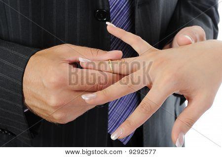 Groom Wears The Ring Bride