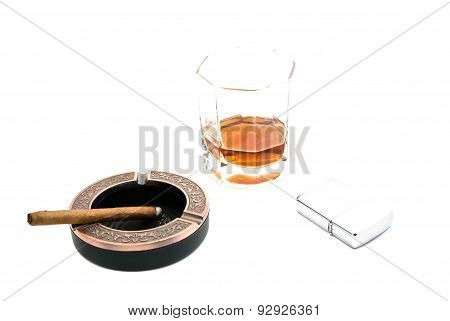 Lighter, Cigarillo In Ashtray And Whiskey