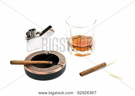 Cigarillos, Ashtray, Lighter And Glass Of Whiskey